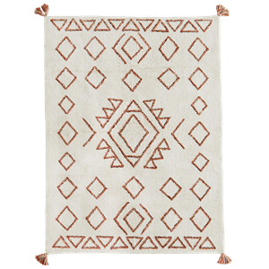 Tufted cotton rug w/ tassels